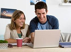 Man and woman looking at laptop screen together