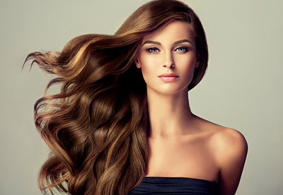 Model with flowing hair and professional makeup