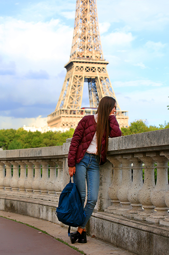 International Student on bridge near Eiffel Tower