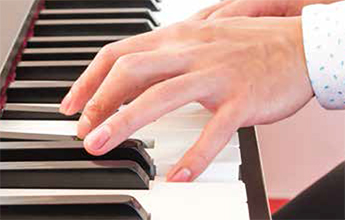Hands on piano keys laying